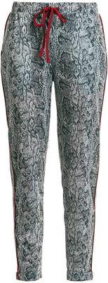 Joggingové nohavice s celoplošnou haďou potlačou