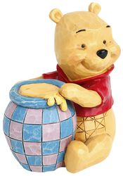 Medvedík Pu s pohárom medu